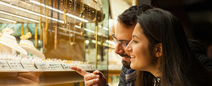 Couple picking an engagement ring together