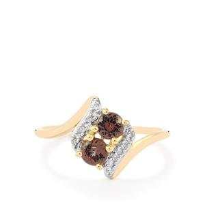 Color Change Garnet Ring with Diamond in 10k Gold 0.65ct