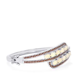 Ethiopian Opal Oval Bangle with Anthill Garnet in Sterling Silver 4.10cts